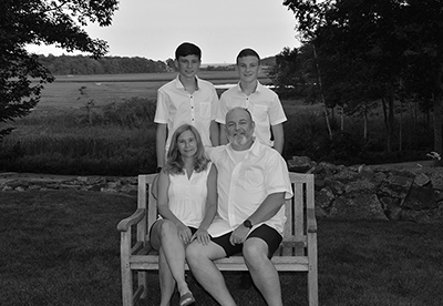 Robin Clapp with husband and two sons